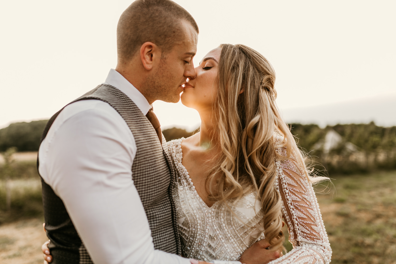 bride and groom kiss during the Sunset by PReston Court Wedding Photographer