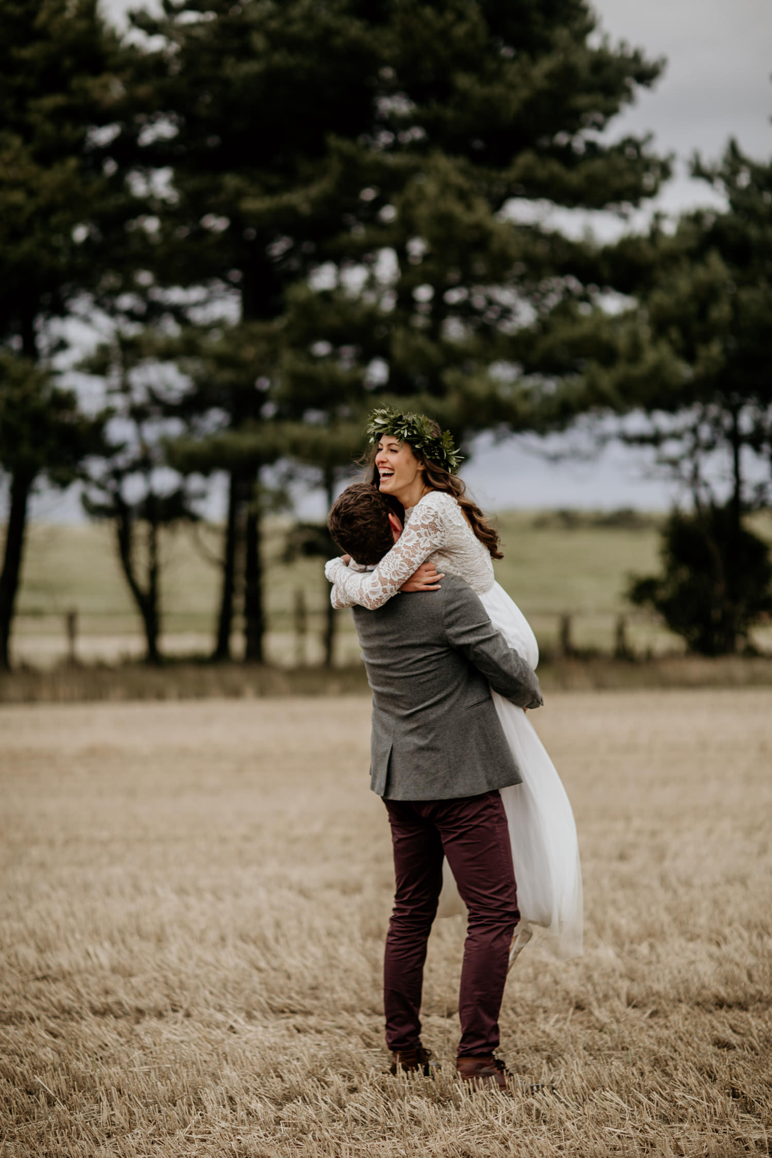 groom lifting bride into the air during the wedding portraits at Harvest Moon, Scotland