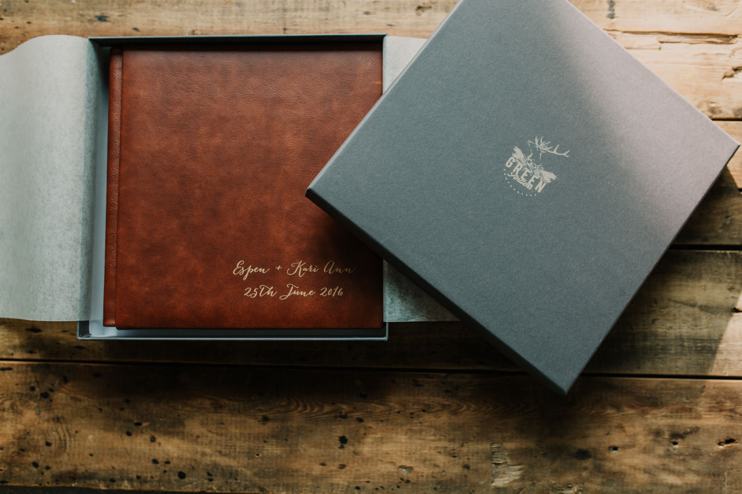 presentation box with Green Antlers Photography logo and cognac brown leather wedding album