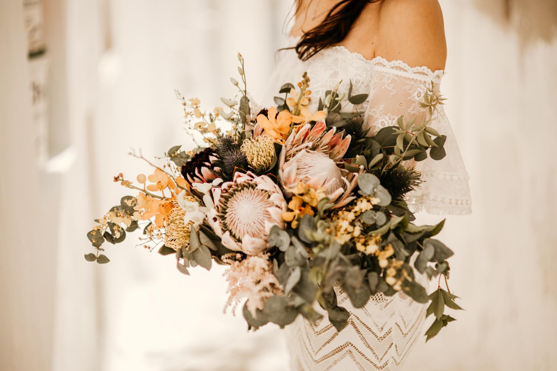 bohemian wedding flowers with King proteas flowers and eucalyptus