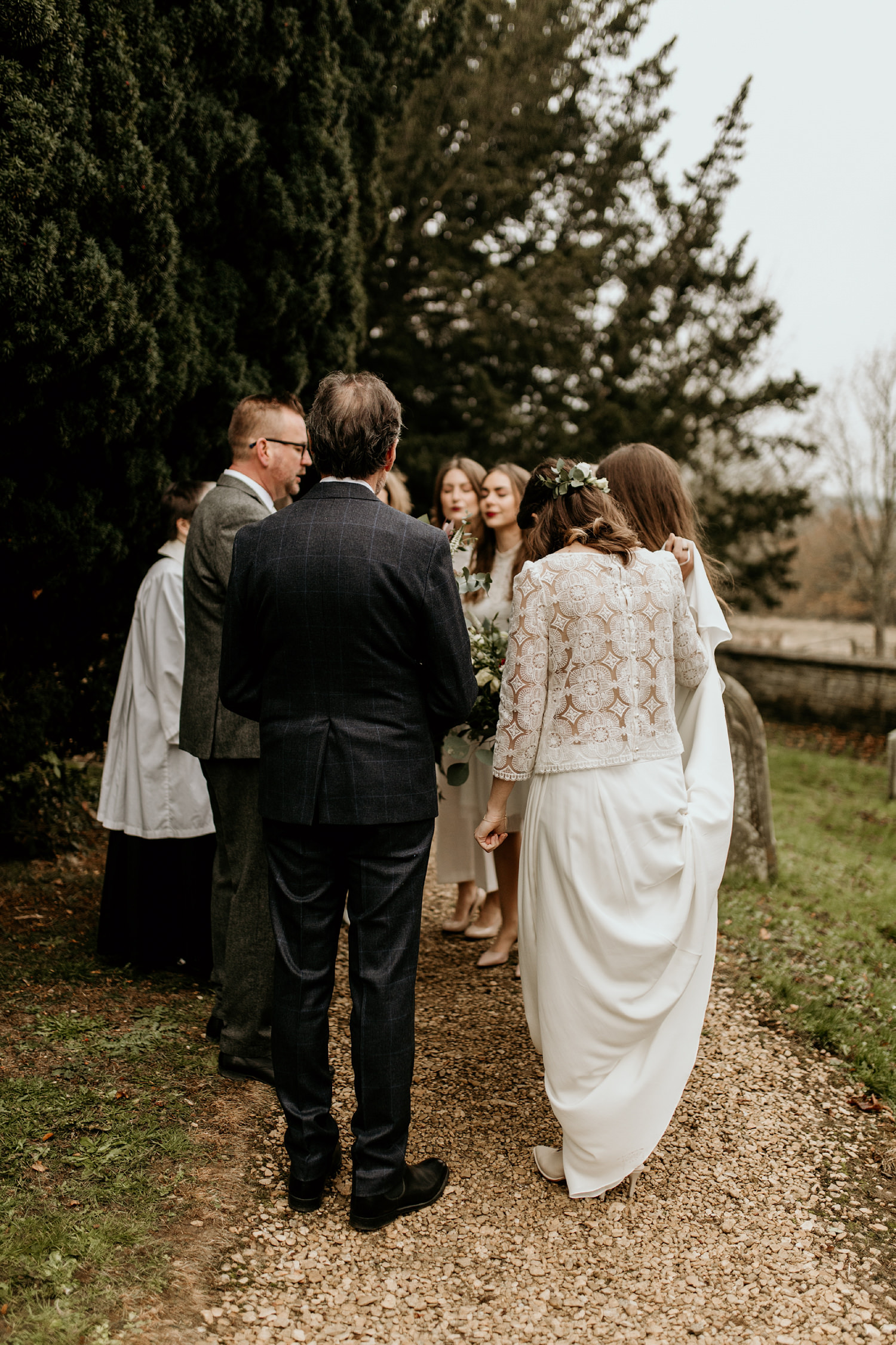 bride and bridesmaids praying before the wedding ceremony Stroud Cotswolds wedding photographer