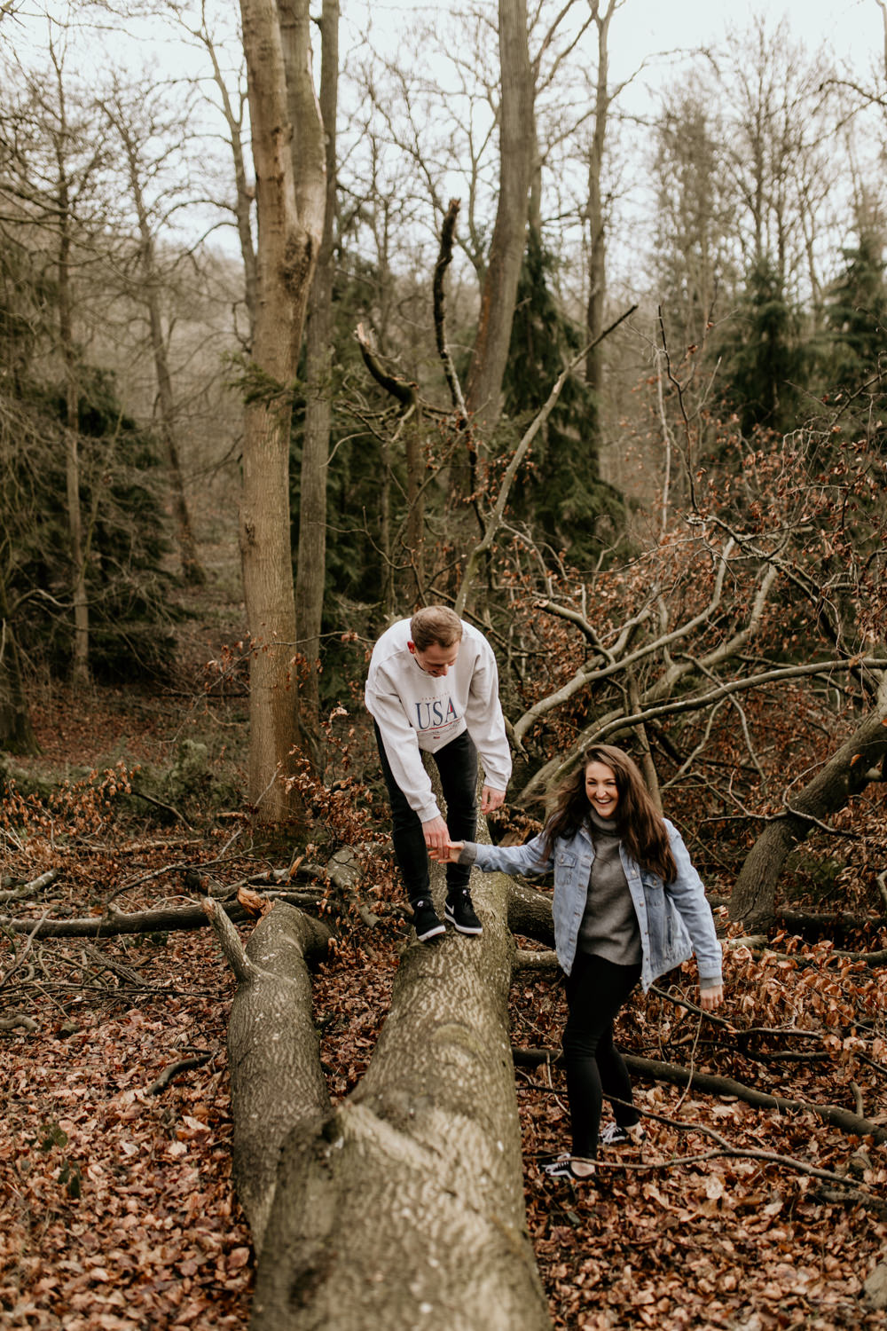couple during their engagement session in the forest near Broadway Tower Cotswolds