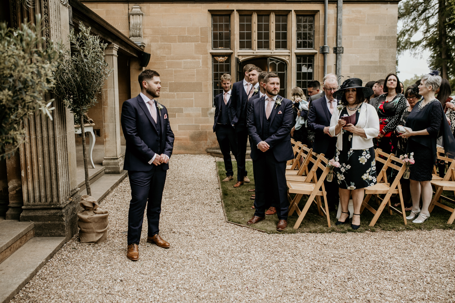 groom waiting for bride for their outdoor wedding ceremony at Coombe Lodge Blagdon wedding