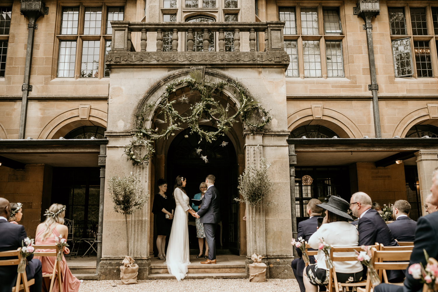 bride and groom wedding vows for an outdoor wedding ceremony at Coombe Lodge Blagdon wedding venue