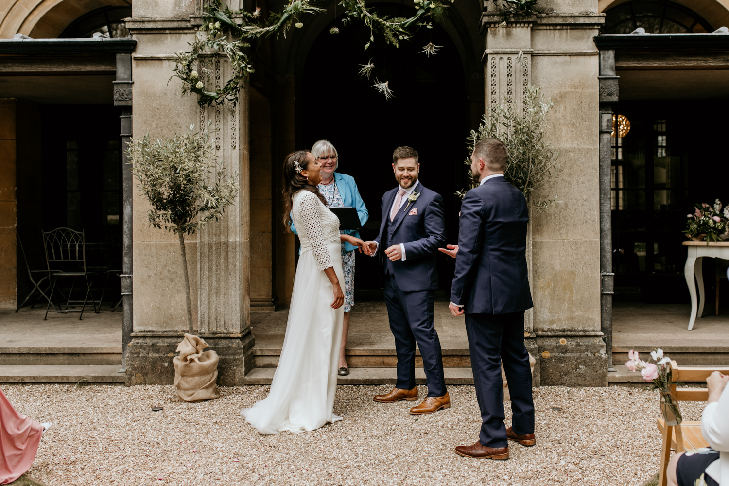 ring exchange for an outdoor wedding ceremony at Coombe Lodge Blagdon wedding venue