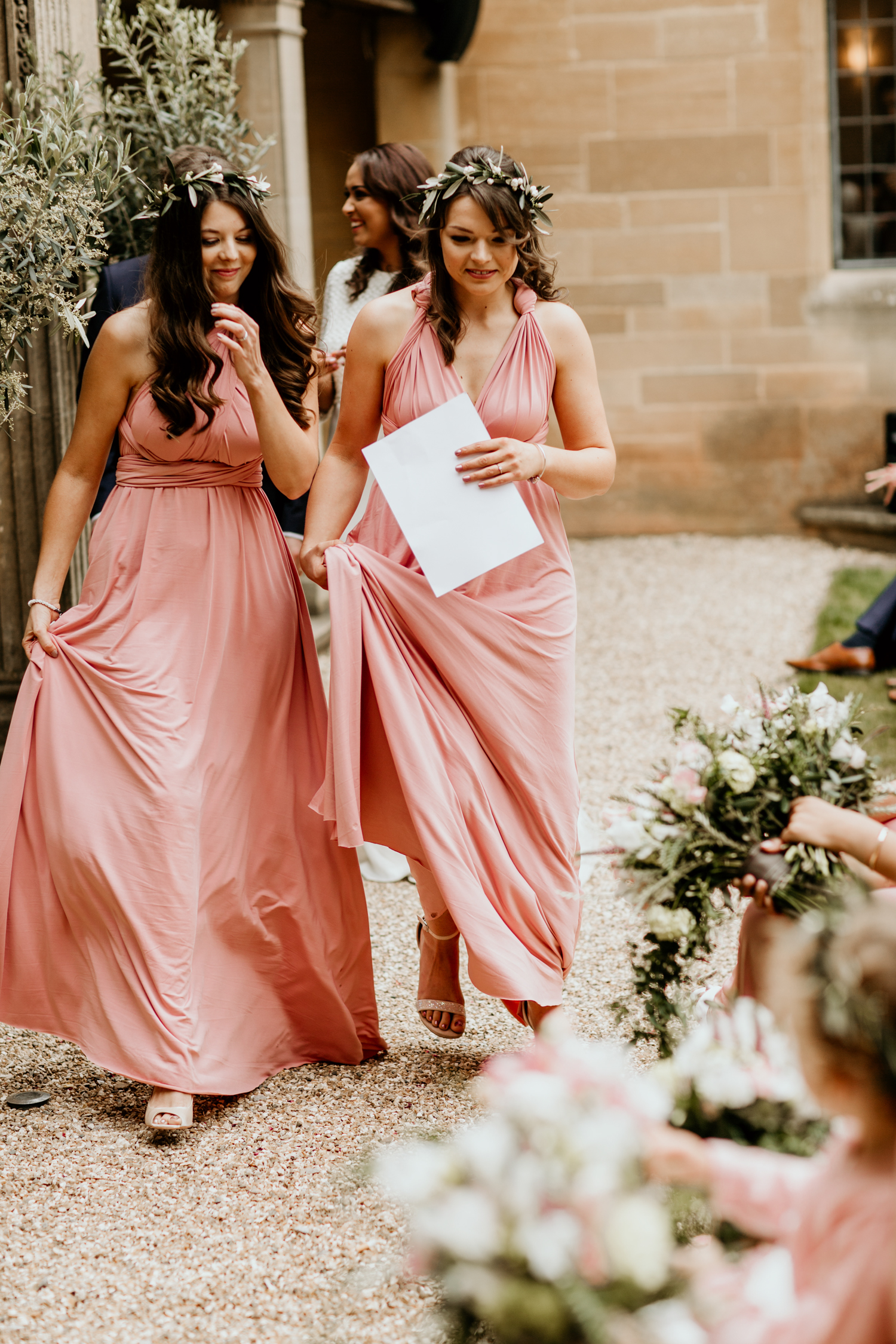bridesmaids wearing a multi way wear bridesmaids coral dress for an outdoor ceremony at Coombe Lodge Blagdon wedding