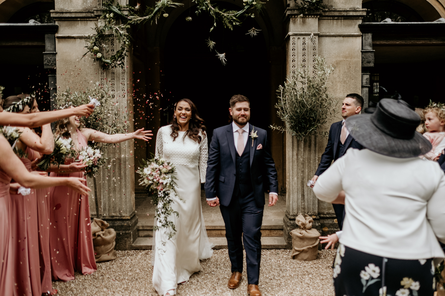 bride and groom walking down the aisle after their outdoor ceremony at Coombe Lodge Blagdon wedding venue