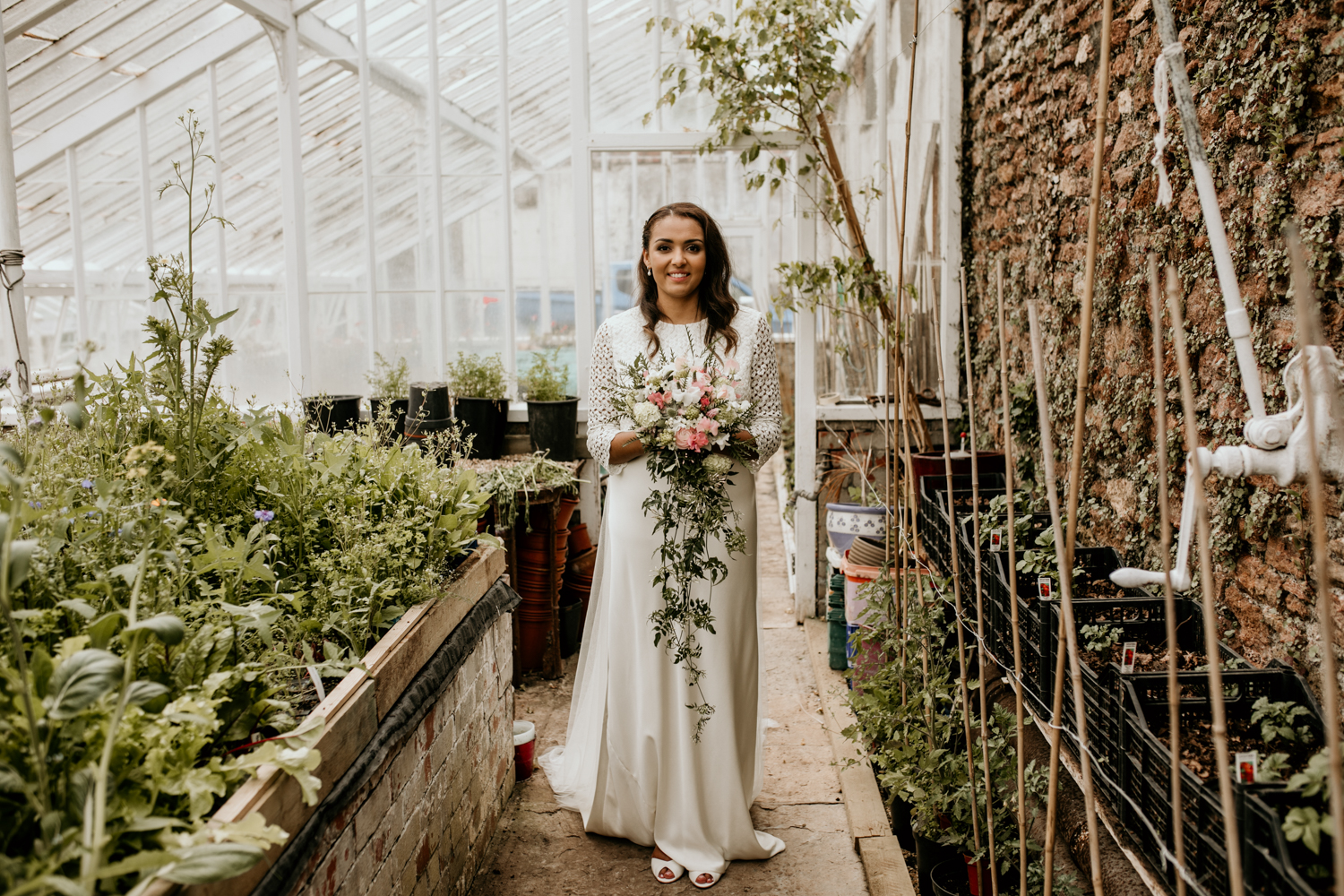 beautiful bride wearing a charlie brear simple wedding dress at Coombe Lodge Blagdon wedding venue