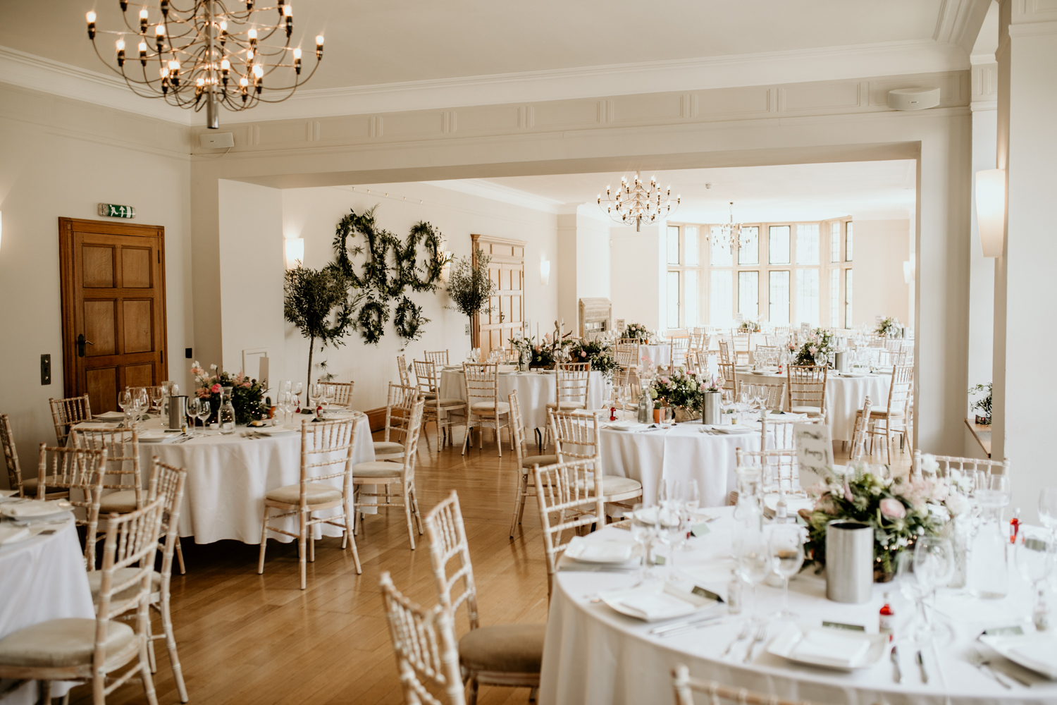 reception room with round tables at Coombe Lodge Blagdon wedding venue