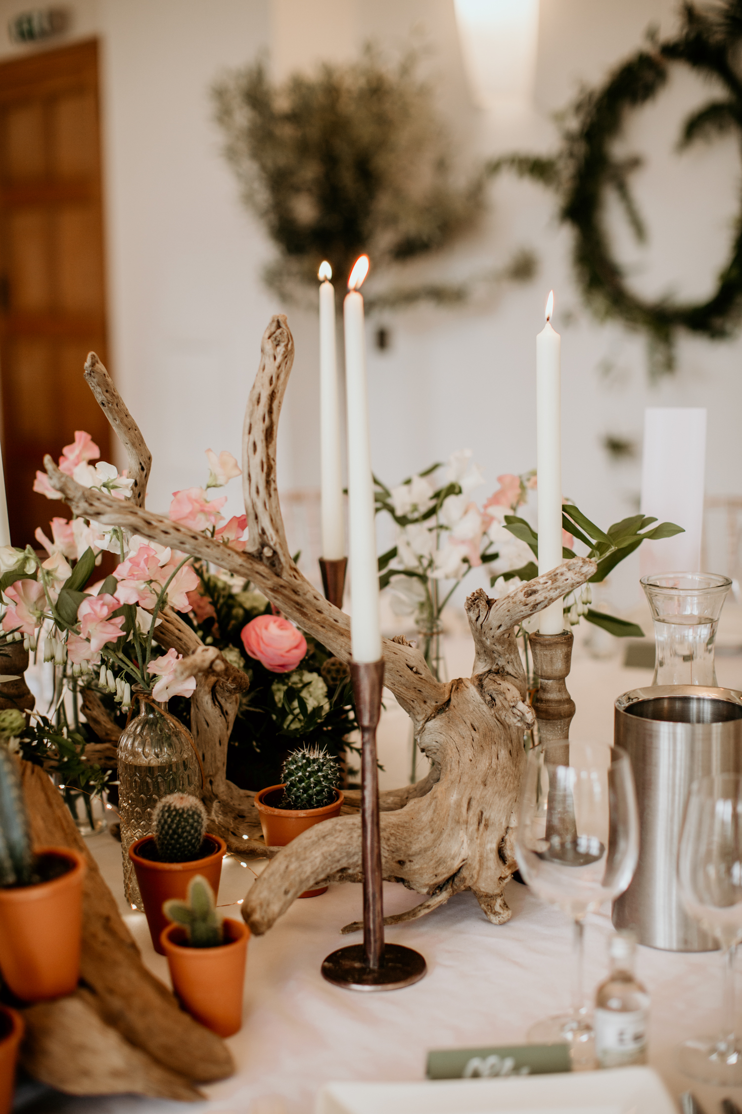 wedding decor with copper candles and drift wood on top table
