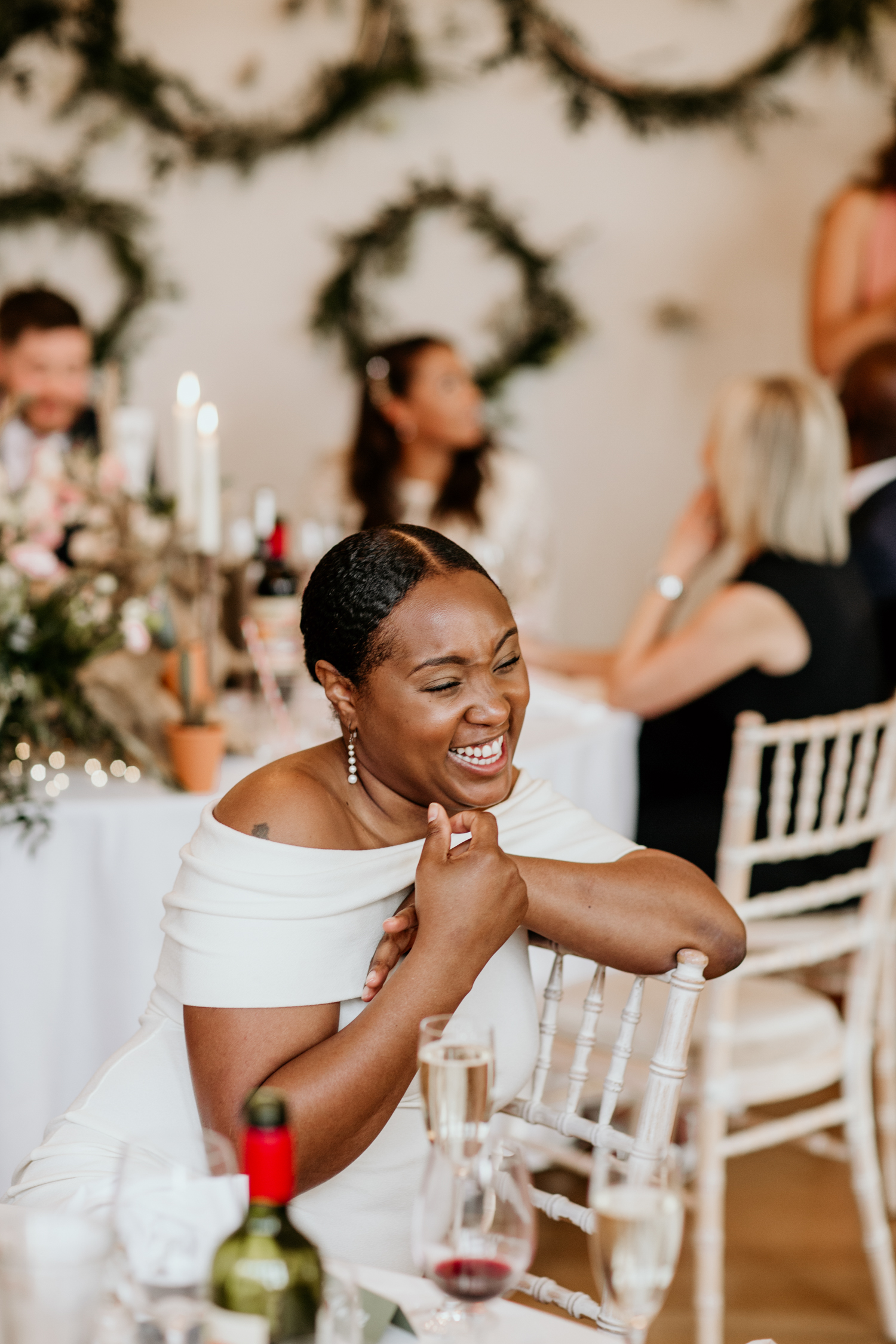 guests laughing during speeches at Coombe Lodge Blagdon wedding