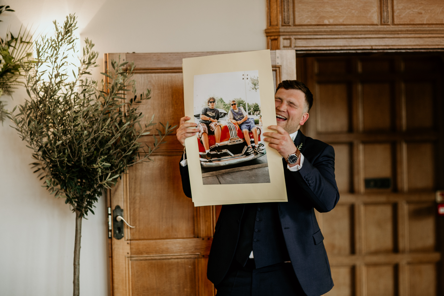 best man speech holding a picture at Coombe Lodge Blagdon wedding venue