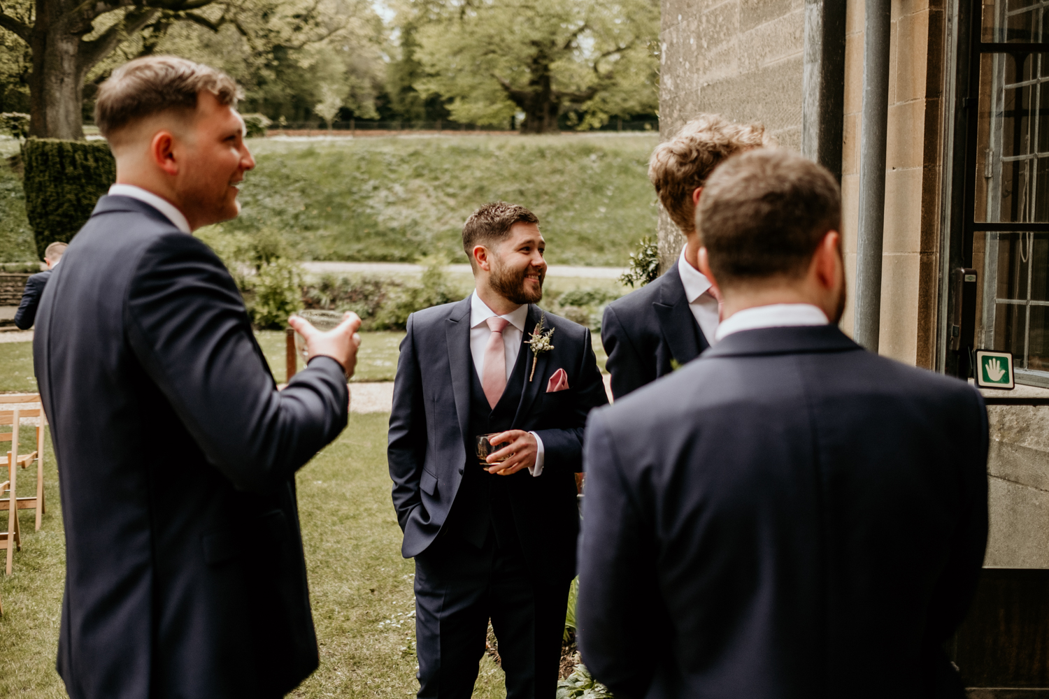 groom drinking with groomsmen before the outdoor ceremony at Coombe Lodge Blagdon venue