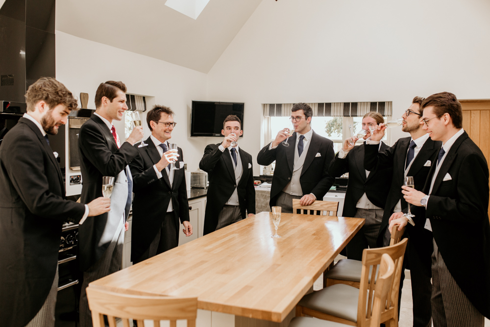 groomsmen toasting before a wedding ceremony in Poulton