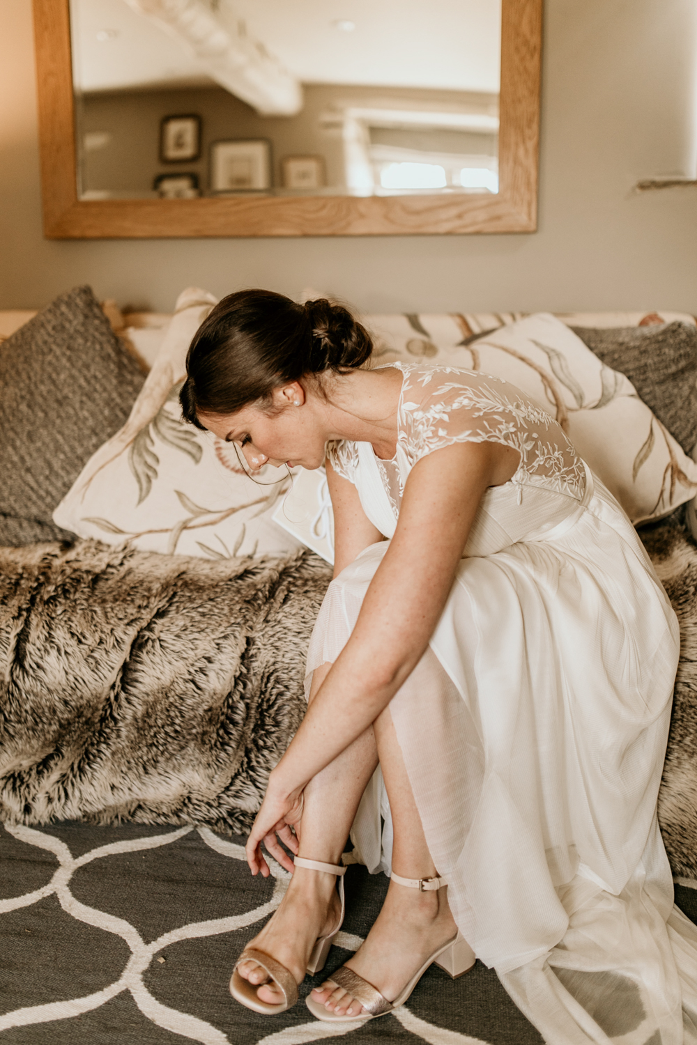 bride wearing her bridal shoes