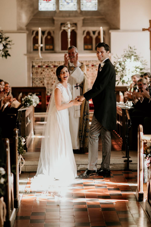bride and groom wedding ceremony in Poulton church