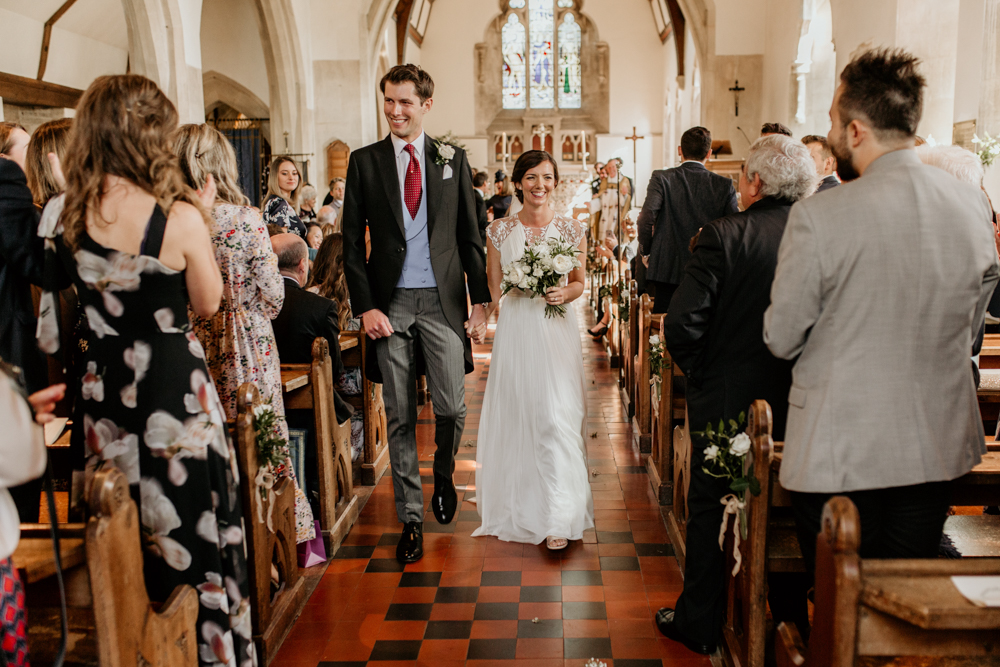 bride and groom walking down the aisle after their wedding ceremony Poulton