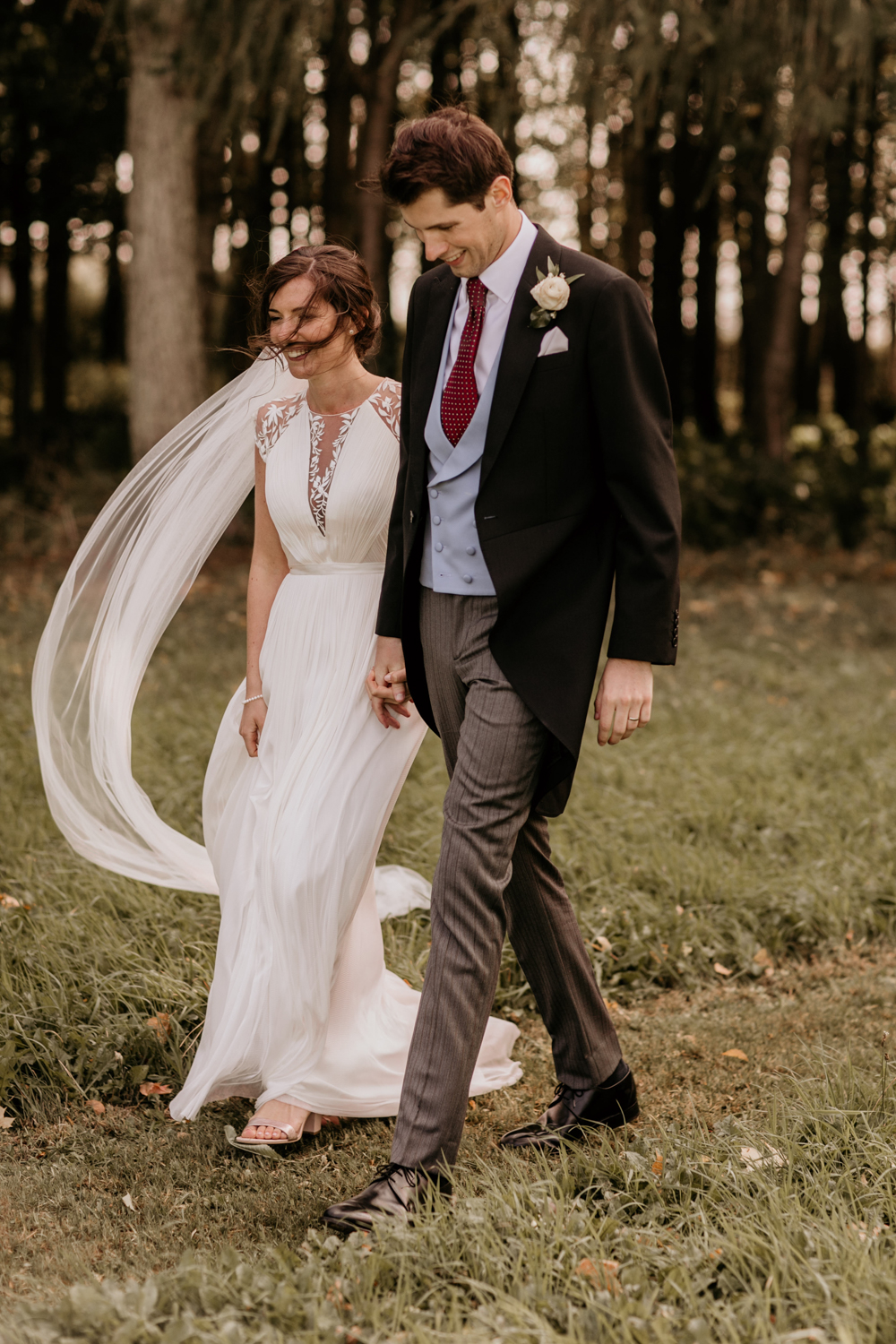 bride and groom walking during their Poulton wedding