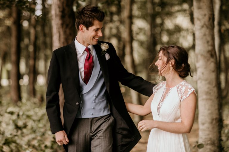 bride and groom portraits in a forest for their Poulton wedding