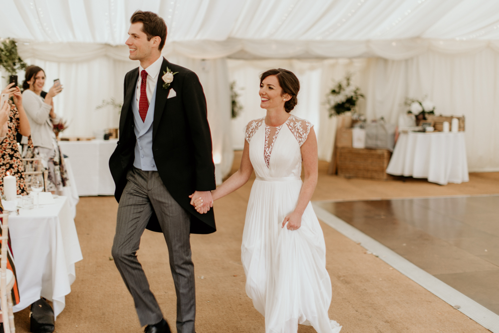 bride and groom entrance for their marquee wedding in poulton