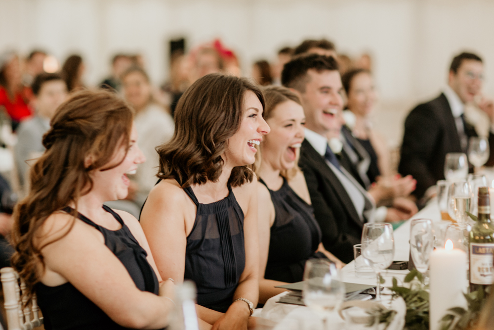 guests laughing during a Poulton wedding speeches