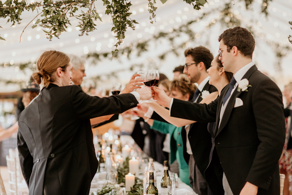 guests toasting during wedding speeches for a Poulton wedding