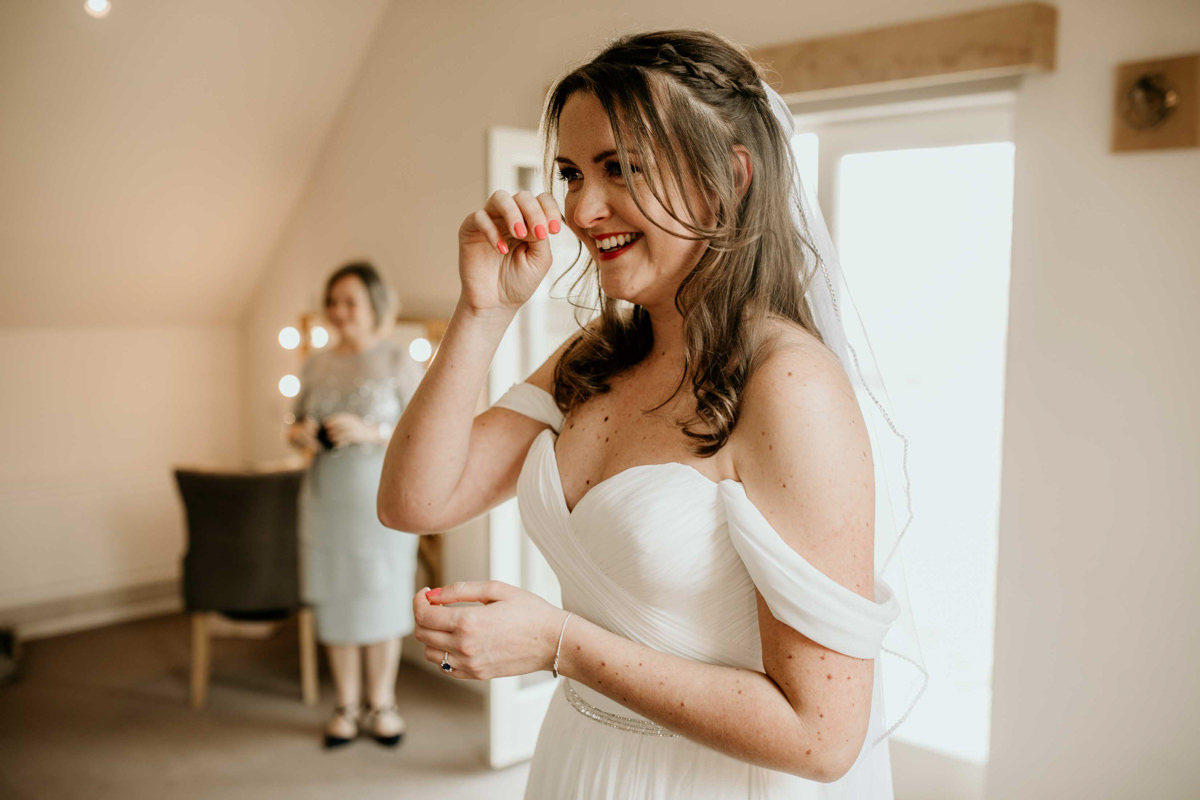 bride tearing seeing her dad with his wedding gift during their first look