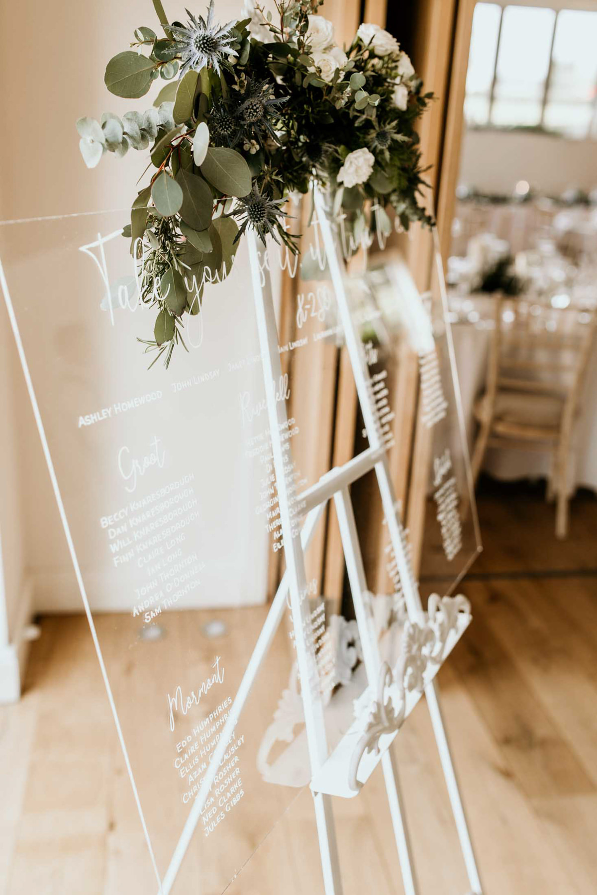 wedding list for guests on plexiglass at hyde house