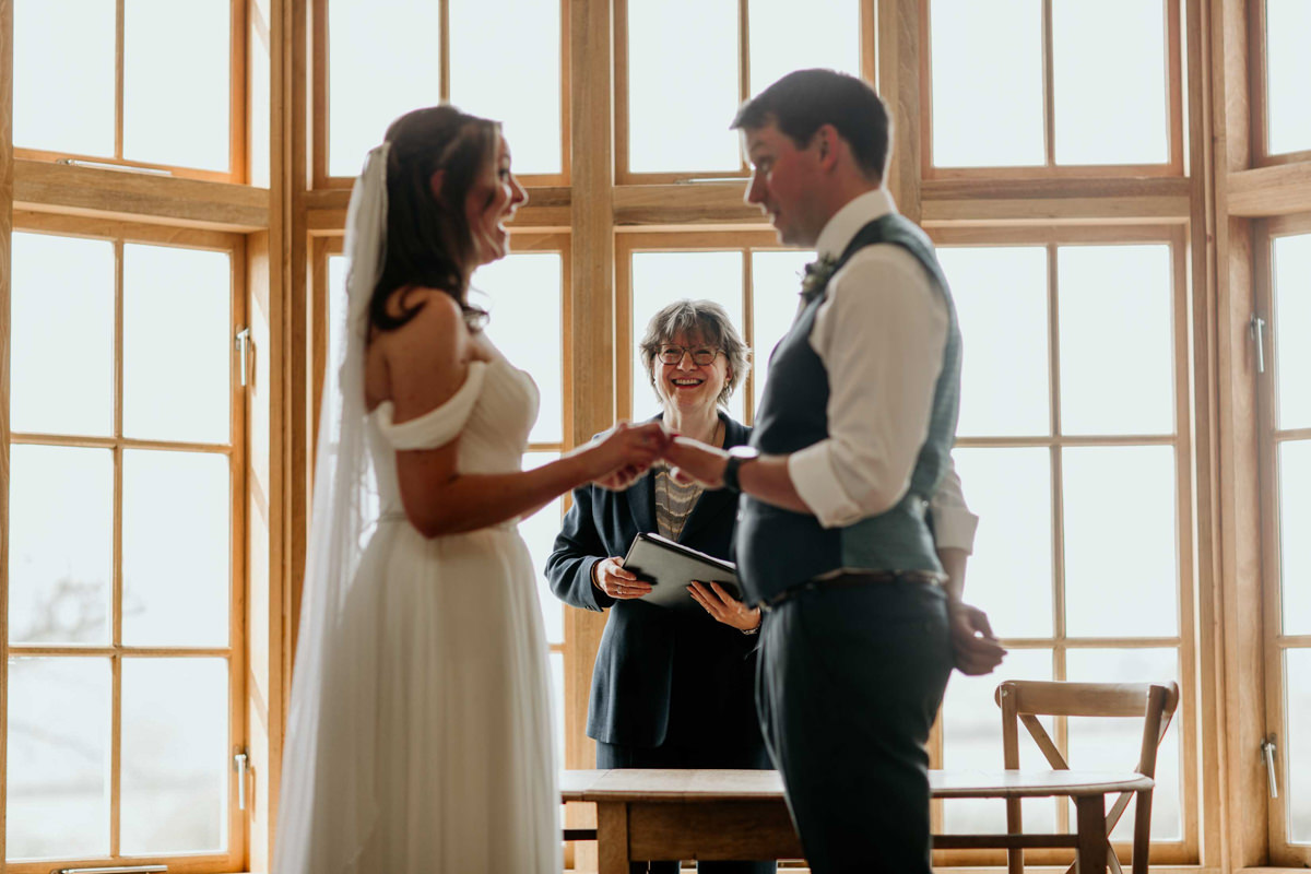 wedding vows during a ceremony at the grange in hyde house