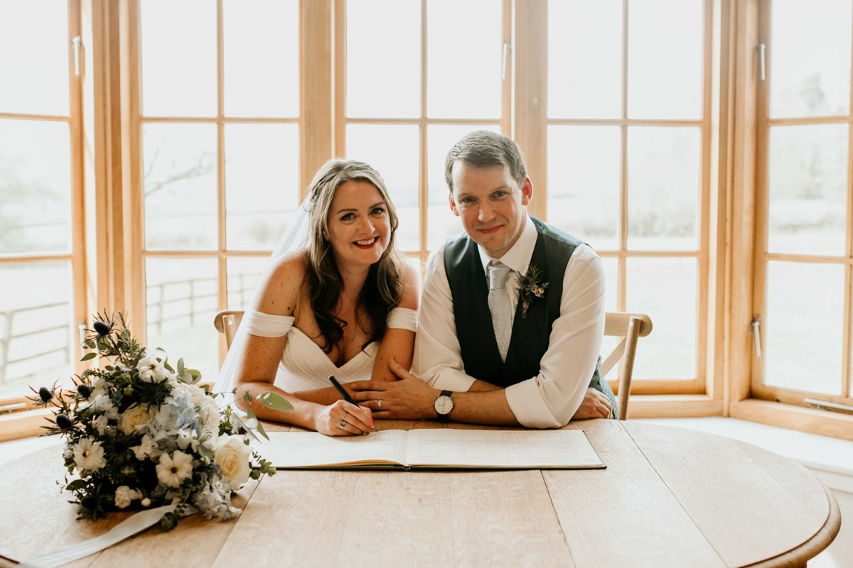 bride and groom wedding ceremony at hyde house in the grange