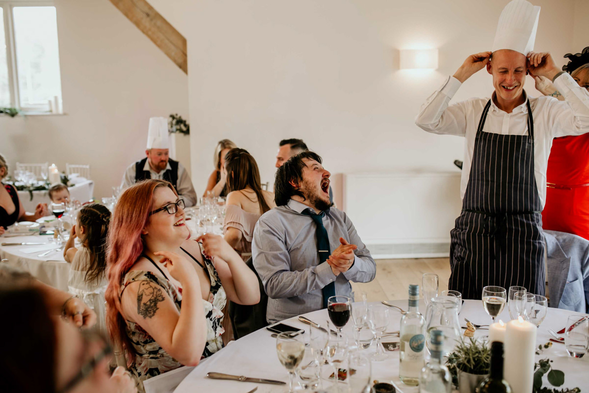 guests laughing at the table during a hyde house wedding reception