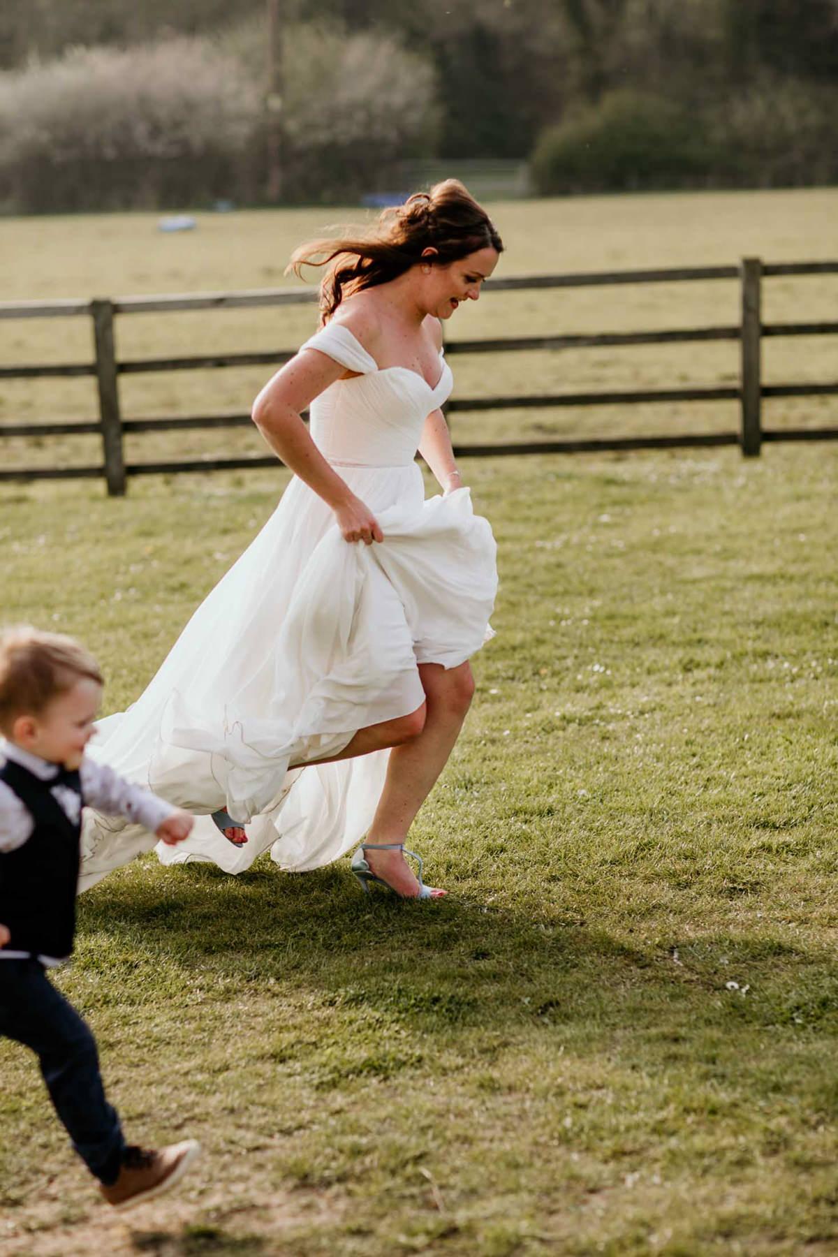 bride running at hyde house wedding venue