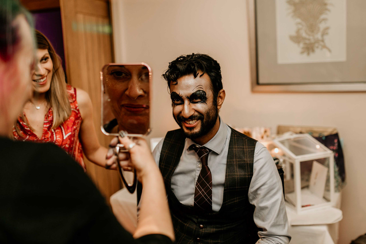 guests at wedding getting glitter on the face at hyde house wedding venue