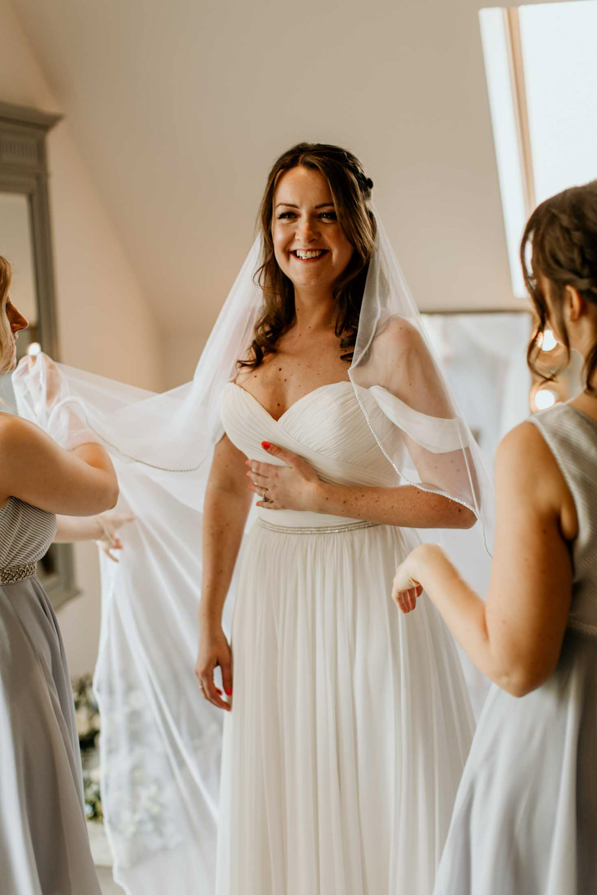 bride getting veil on for her wedding at hyde house
