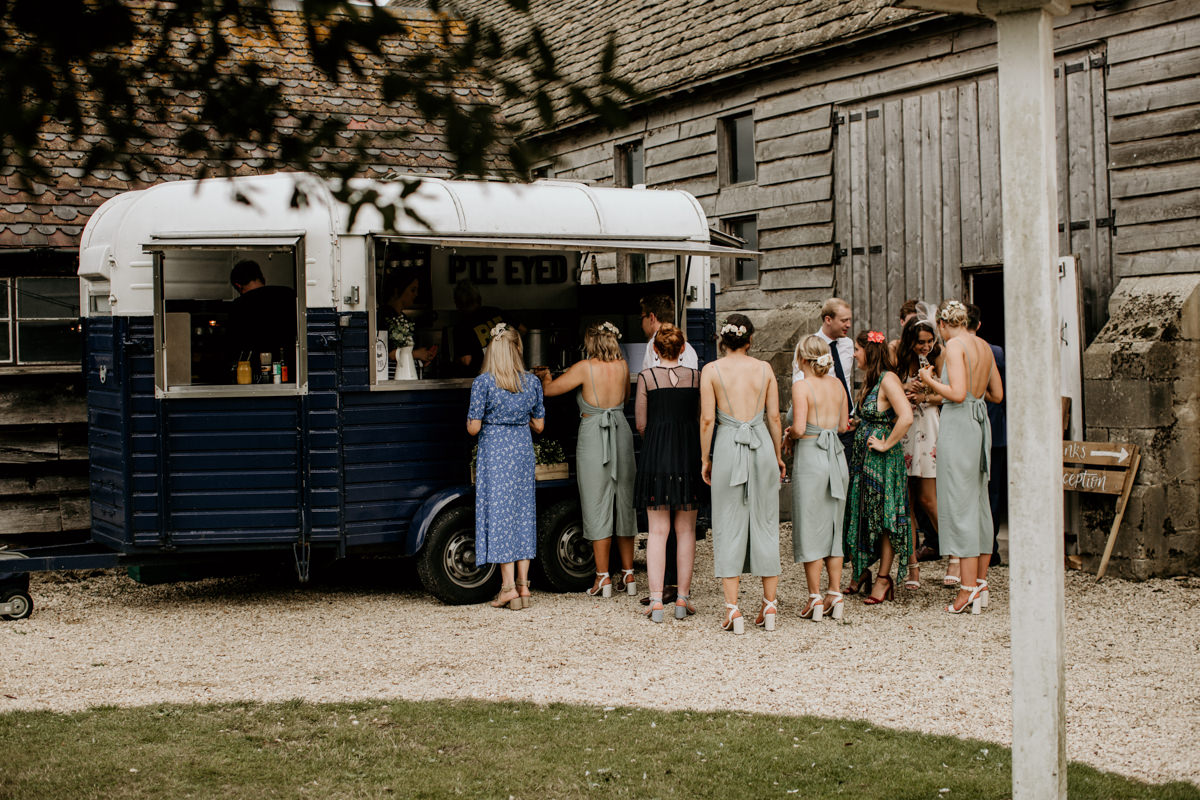 guests in line for a fresh pie during the wedding reception at Priors Court Barn Gloucestershire