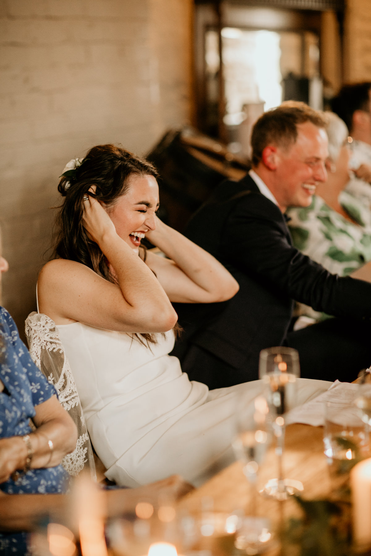 bride laughing during speeches at Priors Court Barn by Gloucester wedding photographer