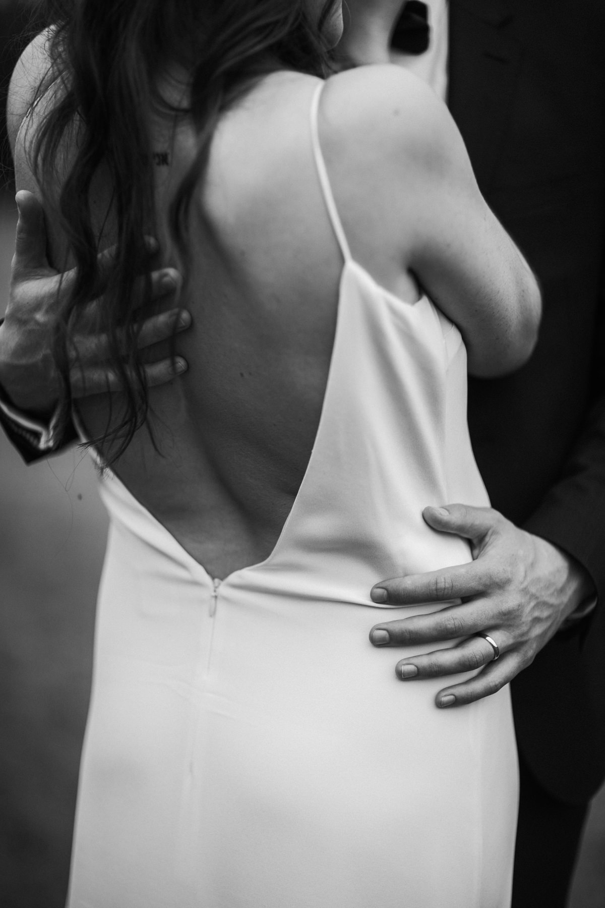 black and white image of dress details at Priors Court Barn