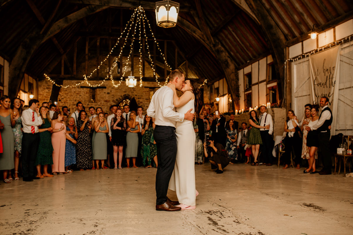 bride and groom first dance during the wedding reception at Priors Court Barn