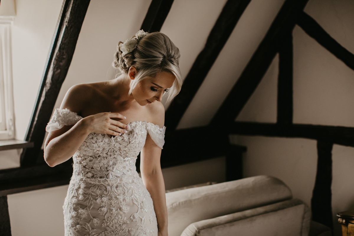 bride on the morning of her wedding in her dress