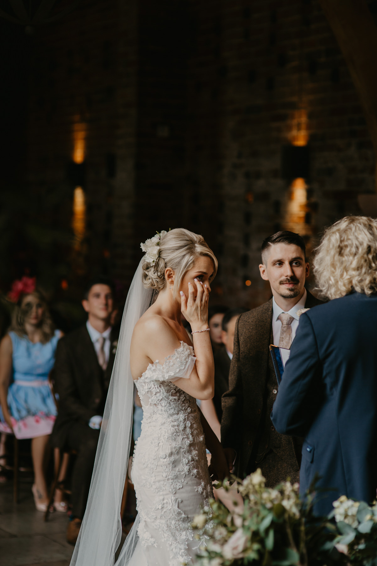 bride getting emotional during her Shustoke Barn wedding ceremony