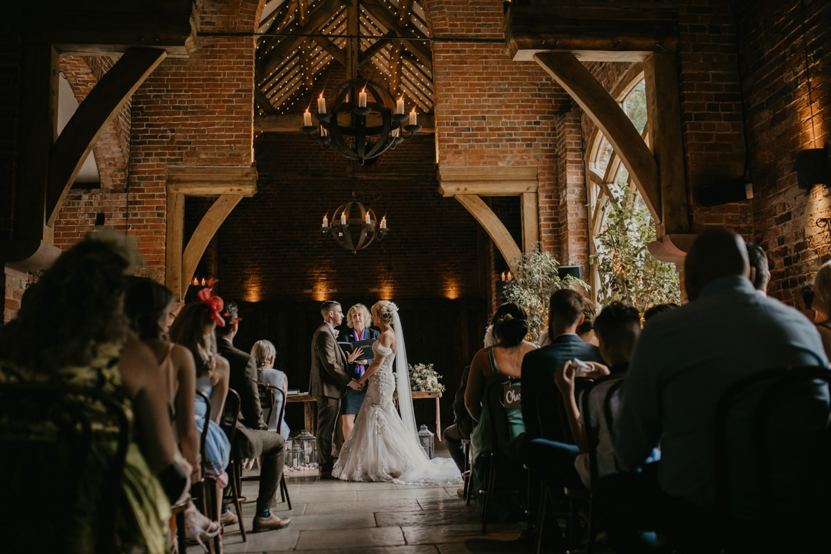 wedding ceremony at Shustoke Barn by Cotswolds wedding photographer