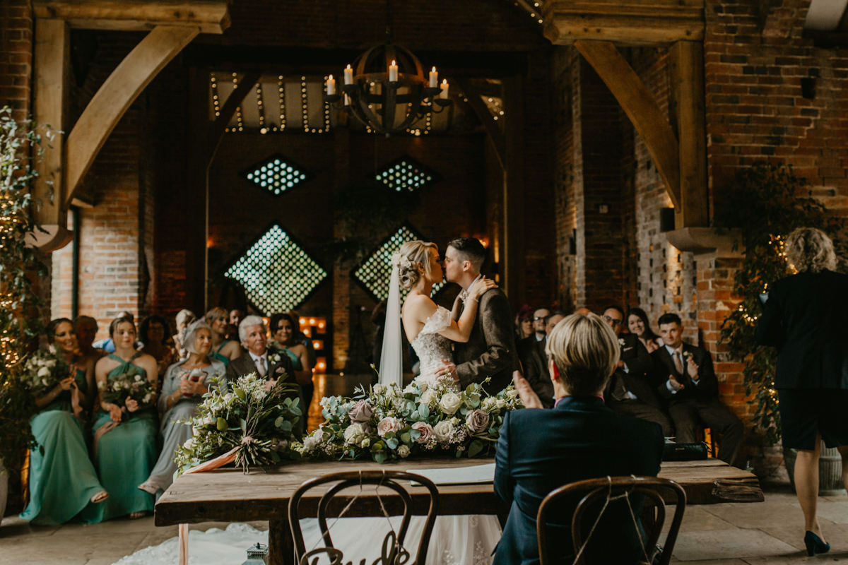 first kiss during a Shustoke Barn wedding ceremony