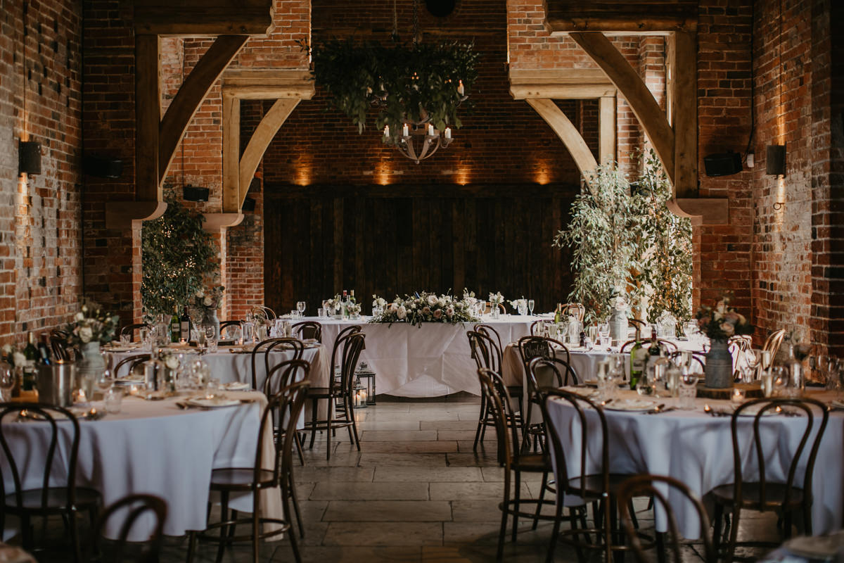 reception area with round tables at Shustoke Barn wedding venue