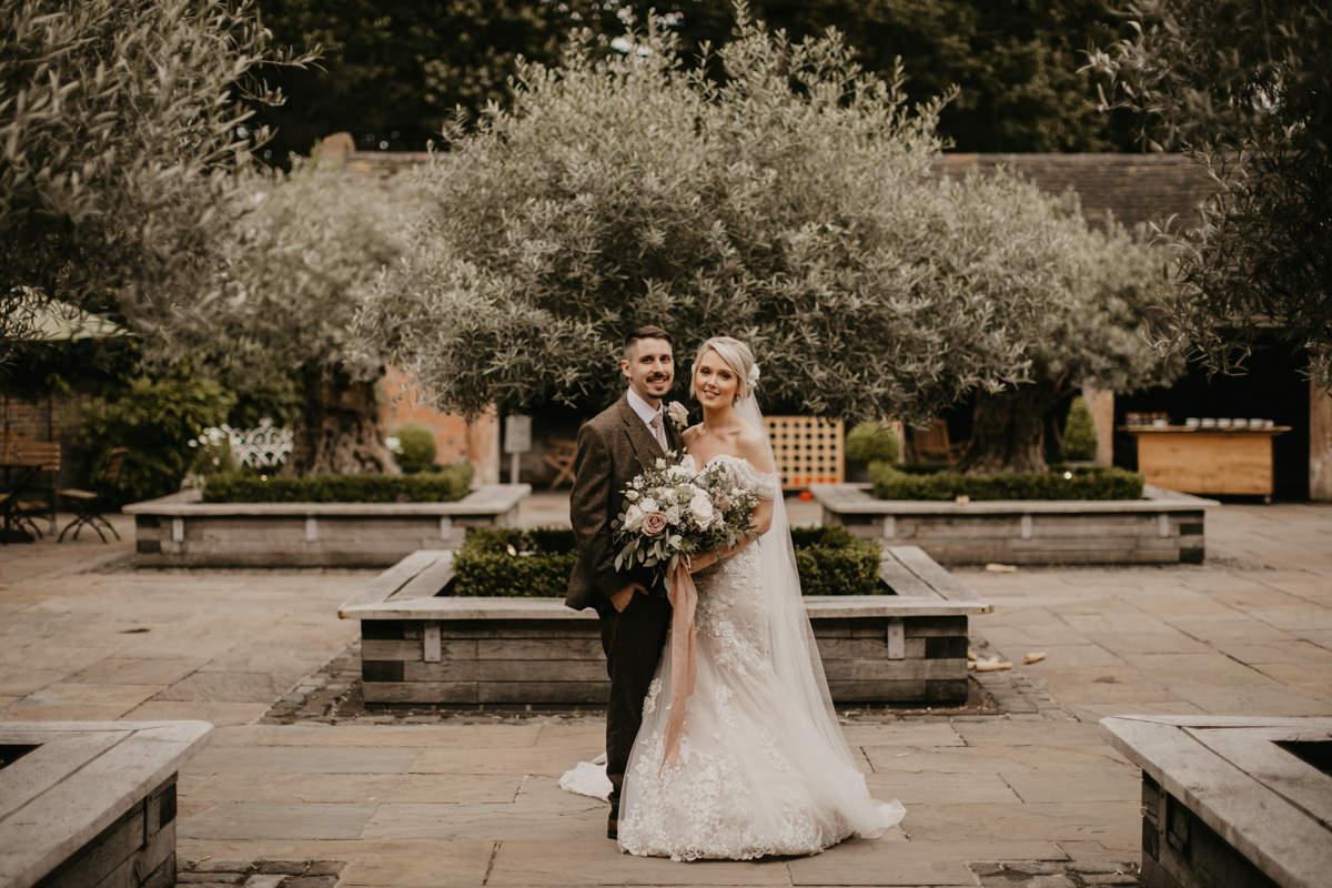 bride and groom during wedding portraits at Shustoke Barn wedding venue