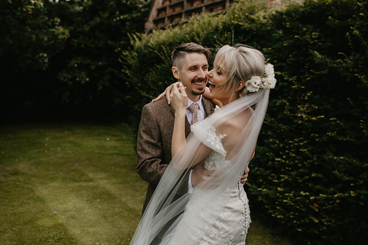bride and groom portraits by Shustoke Barn wedding photographer