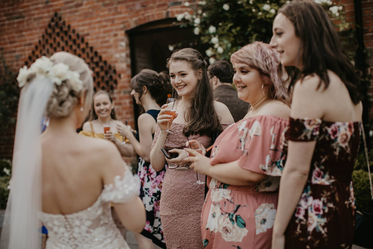 candid shots of guests during a Shustoke Barn wedding venue