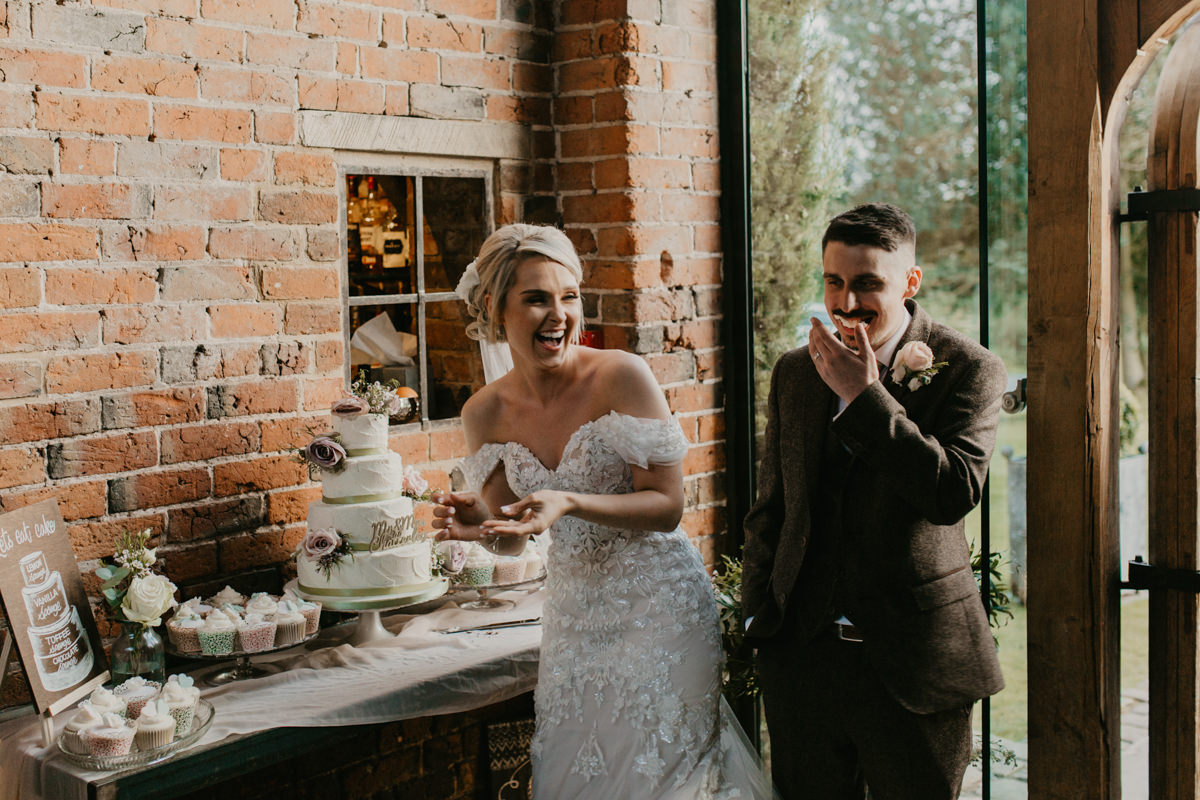 cake cutting at Shustoke Barn wedding venue