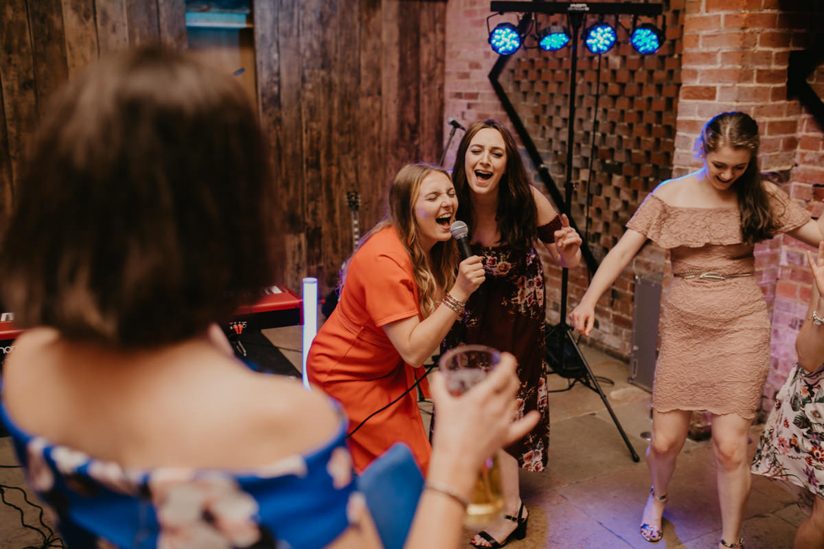 guests dance during the wedding reception at Shustoke Barn wedding venue