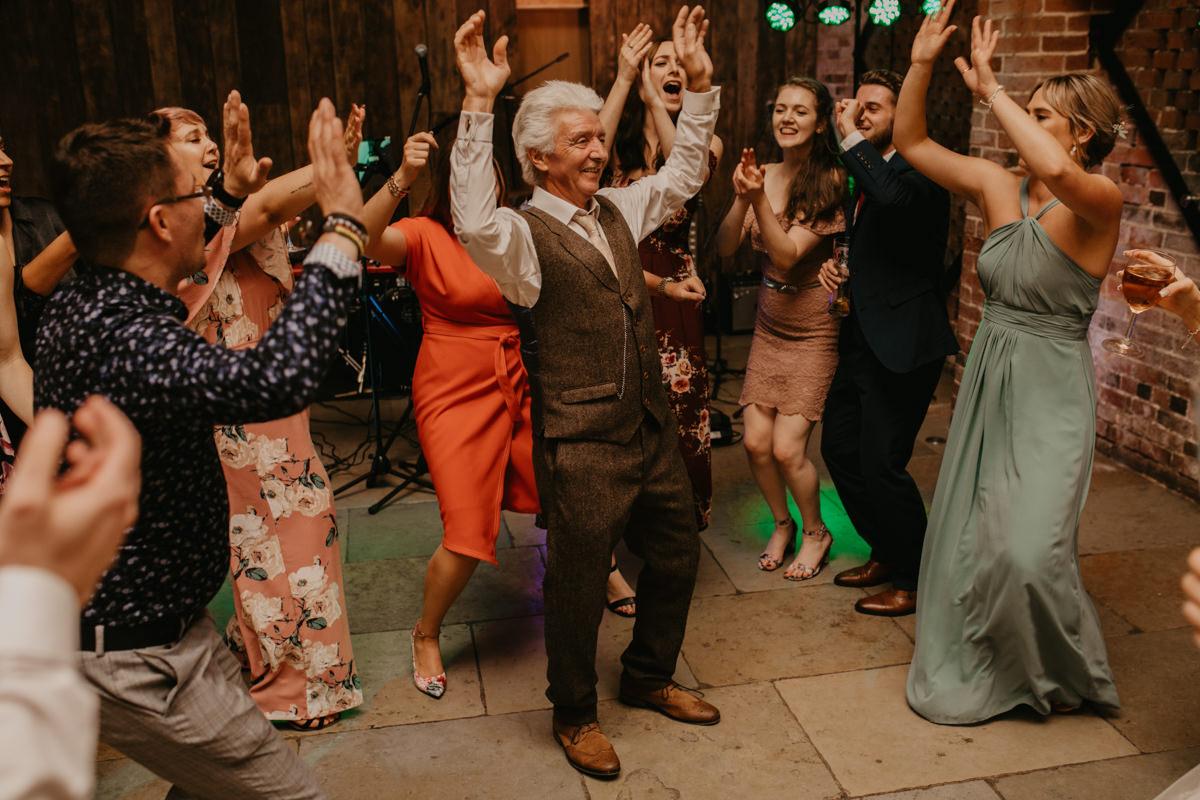 guests dance at Shustoke Barn wedding reception