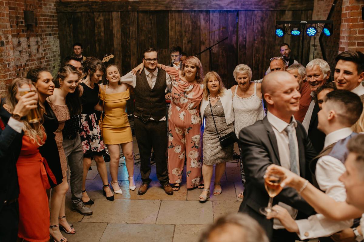 guests during the wedding reception at Shustoke Barn wedding venue